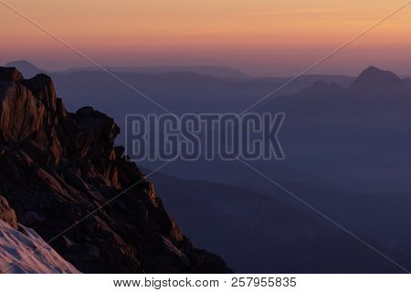Colorful Sunset On Top Of Mountain Alps