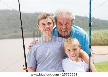 portrait of grandpa and grandsons fishing