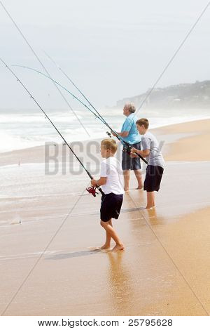 grandfather and two grandsons fishing on beach