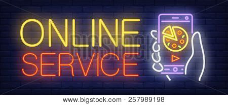 Online Service Sign In Neon Style. Yellow And Red Text, Hand Holding Mobile Phone With Pizza On Scre