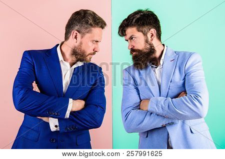 Businessmen stylish appearance jacket pink blue background. Tense face expression competitors. Business competition and confrontation. Business partners competitors in suits with tense bearded faces poster
