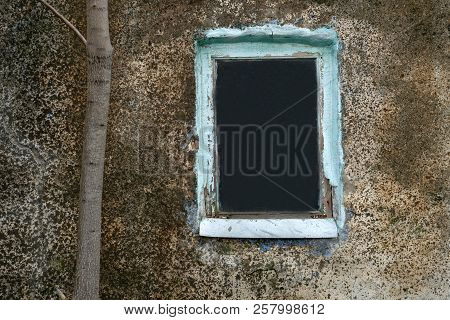 Old Window On An Abandoned Old Building. Old And Dirty Wall Of The Interior Of Old Buildings.