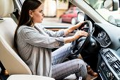 Beautiful blonde woman beep in the car in panic with closed eyes while driving on high speed. poster