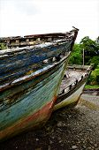 A view of rusting and rotting boats in Salen bay on the Isle of Mull poster