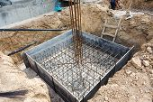 Foundation construction building site making reinforcement metal framework for pouring concrete. Metal mold for cement construction. Cement foundation for house building poster