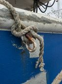 Corroded shackle, frayed line and paint patches on old fishing boat poster