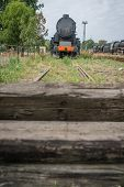 An old disused retro steam train locomotive at the end of the line poster