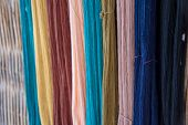 Thai silk yarn dyed natural, prepare for fabrication poster