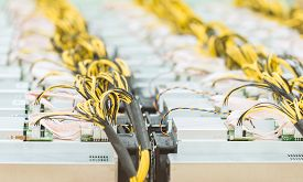 Rows Of Dedicated Asic For Cryptocurrency Mining Farm. Bitcoin, Ethereum And Other Altcoins Producin