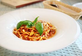 White Plate With Pasta Bolognese With Leaves Of Fresh Basil