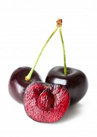 Twig Of Cherry And The Half Isolated On White Background