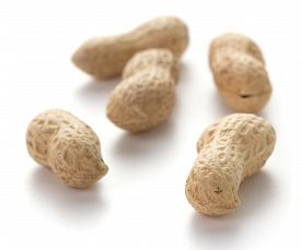 Heap Of Peanuts In Nutshell On White Background