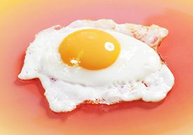 Close-up View Of Sunny-side Fried Egg On Orange Plate