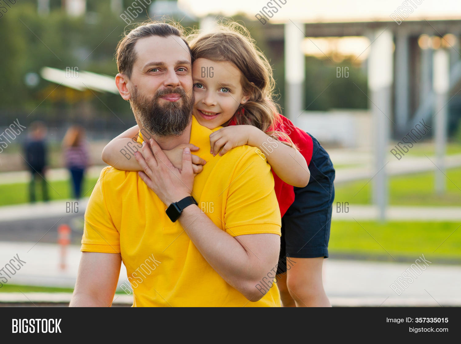 Family Portrait. Daughter Hugs Father. Family Fun. Beautiful Family Together. Leisure Together. Smil