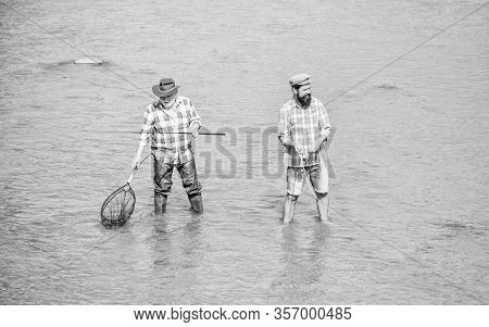 Hobby And Sport Activity. Fishing Together. Teach Man To Fish And You Feed Him For Lifetime. Male Fr