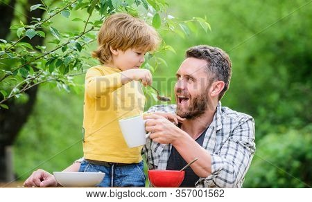 Father Son Eat Food And Have Fun. Feeding Baby. Menu For Children. Family Enjoy Homemade Meal. Food