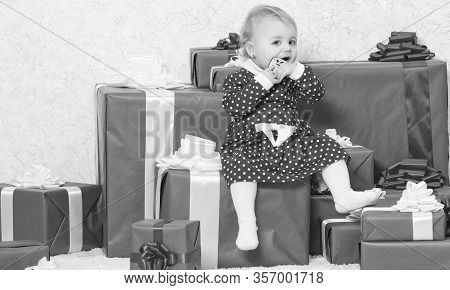 Family Holiday. Little Baby Girl Play Near Pile Of Gift Boxes. Gifts For Child First Christmas. Cele