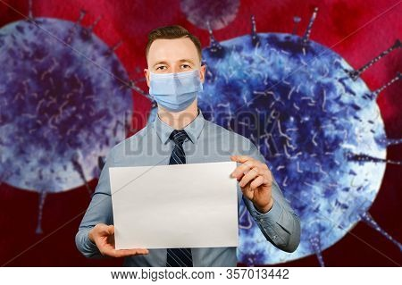 Man Holding Blank Sheet Of Paper A4, Wearing A Protective Face Mask Prevent Virus Infection