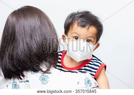 Asian Mother Carry Baby Boy Wear Mask Protect Pm2.5 And Covid-19 Outbreak On White Background