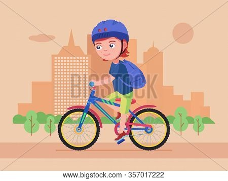 Boy Rides A Bike In The Park. Kid In A Helmet With A Backpack Drives A Bicycle Along The Road In The