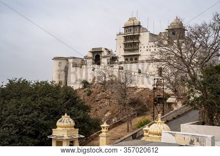 Ancient Monsoon Palace In Udaipur India On A Cloudy Day