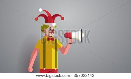 First April Fool Day Man In Funny Jester Hat And Clown Mask Holding Loudspeaker Holiday Celebration