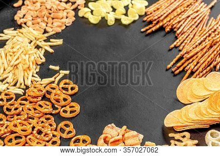 Christmas Party Snacks. The Concept Of The Oktoberfest. Frame With Beer Snacks On Black Background.