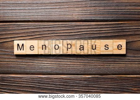Menopause Word Written On Wood Block. Menopause Text On Table, Concept