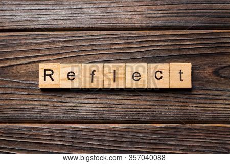 Reflect Word Written On Wood Block. Reflect Text On Table, Concept