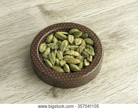 Dry Cardamom Seeds. Light Green Processed Pods Of Elettaria Cardamomum, Dried Seeds, Used As Flavori