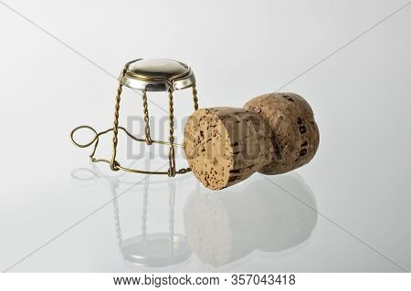 Cork Stopper And Stopper Cage Isolated On White Background With Clipping Path