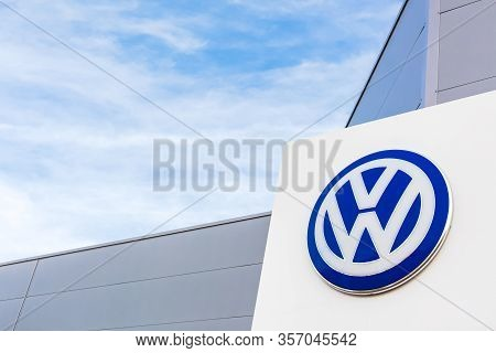 Volkswagen Brand Logo On Bright Blue Sky Background Located On Its Dealer Office Building In Lyon, F