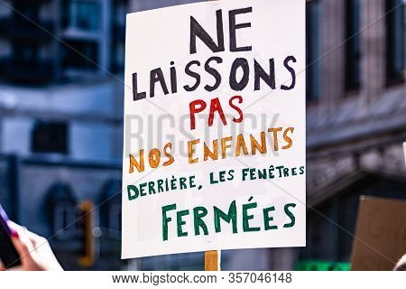 A Close Up Shot Of A French Sign Saying Do Not Leave Our Children Behind Closed Windows, As Protesto