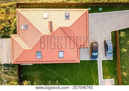 Top Down Aerial View Of A Private House With Red Tiled Roof And Spacious Yard With Parked Two New Ca