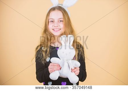 Where Did Easter Rabbit Come From. Little Girl Holding Easter Rabbit Toy. Happy Child Playing With E