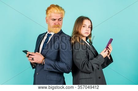 Social Networks. Application Online Services. Internet Surfing. Man And Girl With Smartphones. Moder
