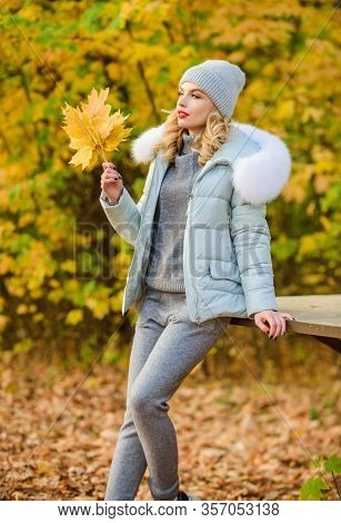 Clothes For Rest. Woman Enjoy Autumn Season In Park. Warm Knitwear. Girl Relaxing In Nature Wearing