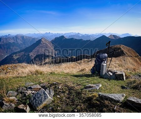 Alpine Panorama With Backpack And Trekking Poles. Conceptual Image Of Adventure And Freedom. Carnic