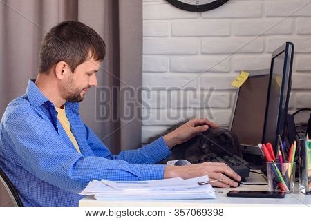 Self-employed Worker Working On A Remote Job Stroking A Cat