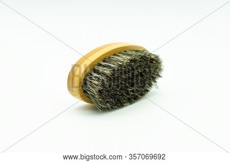 View Of A Bamboo Beard Brush With Natural Bristles Lying On A White Background Concept Of Facial Car