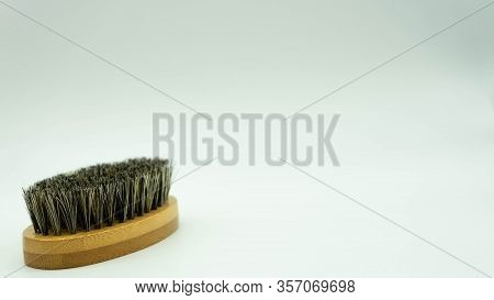 Close-up Of Bamboo Beard Brush With Natural Bristles On White Background On The Left Of The Image Wi