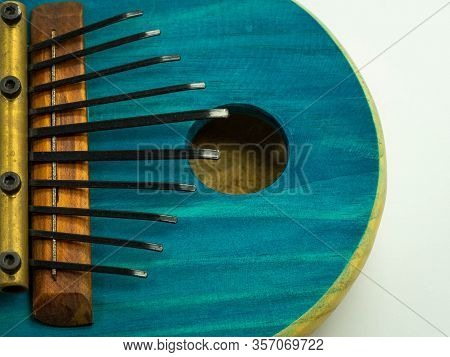Top View Of Blue African Kalimba On A White Background. Traditional Music Concept.