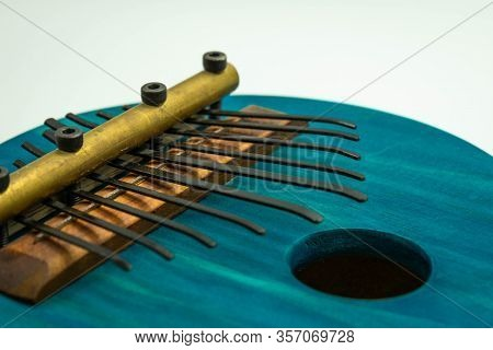 Detailed View Of Blue African Kalimba On A White Background. Traditional African Music Concept