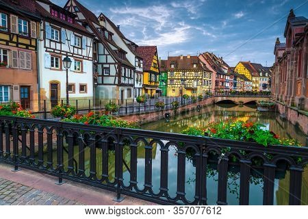 Colorful Houses In Row On The Waterfront With Flowery Promenade, Colmar City Center, Alsace Region,