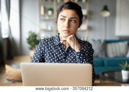 Thoughtful Young Indian Woman Pondering Task, Working On Project