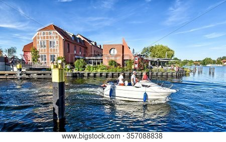 Malchow, Germany - July 9, 2017: Modern Motor Yacht Sails On The Lake At Malchow In Mecklenburg-vorp