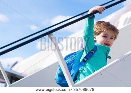 Go Home. Evacuation. A Boy Climbs An Airplane Ladder In Italy. Flight After Travel. Airport And Airp