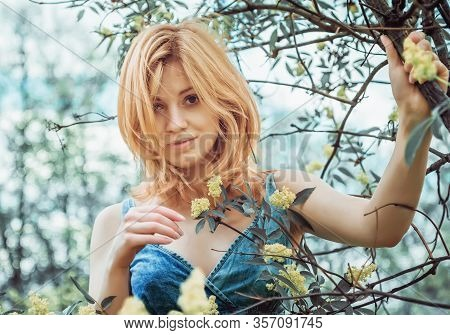 Beautiful Blonde Young Woman In Denim Topic Gently Smiling With Sympathy Looking At The Camera, Stan