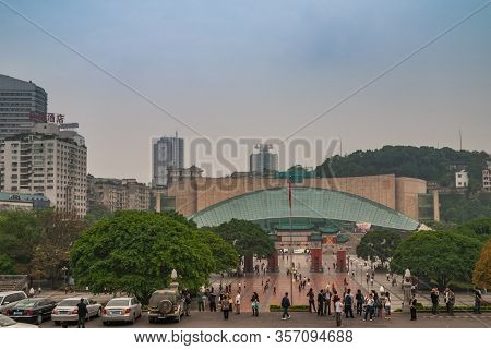 Chongqing, China - May 9, 2010: Downtown. Three Gorges Museum Building Behind Red-green Ornamental G