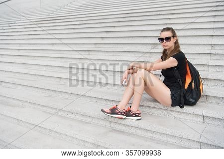 Travel Is Always Good Idea. Sensual Woman Sit On Steps. Tired Traveler Relax On Stairs. Pleasure Tra